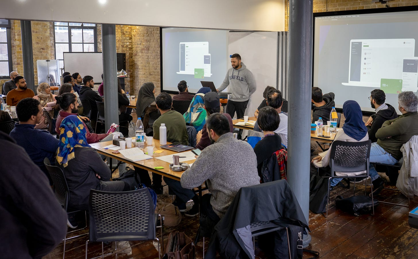picture of guy with laptop teaching a class at a hackathon