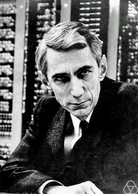Photo of Claude Shannon in front of computer equipment.—https://opc.mfo.de/detail?photo_id=3807, CC BY-SA 2.0 de, https://c