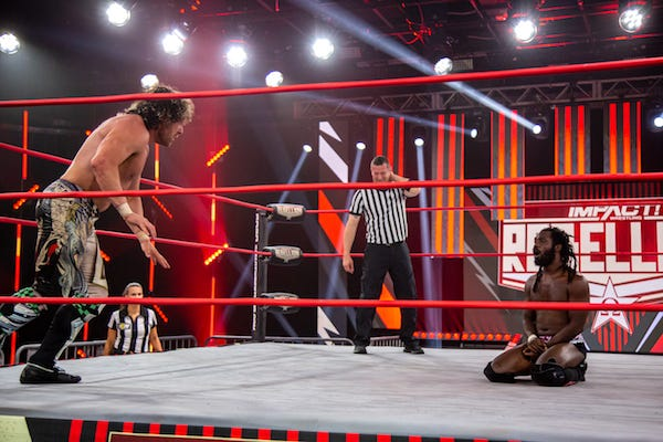 Kenny Omega prepares to hit the V-Trigger on Rich Swann at Impact Rebellion, April 25, 2021