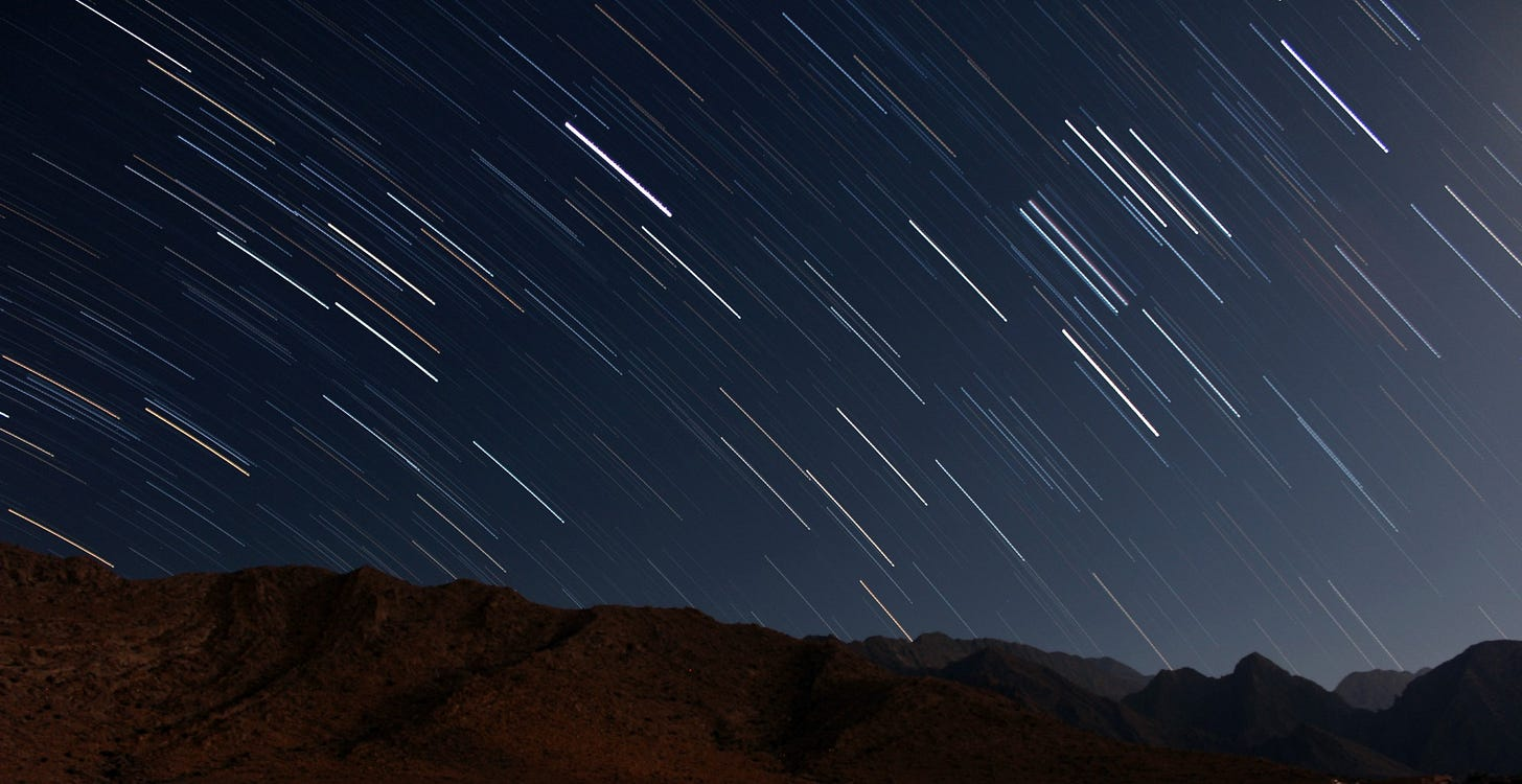 """Image of a star filled sky at night for poem by larry g maguire called """"The Is No Time"""""""