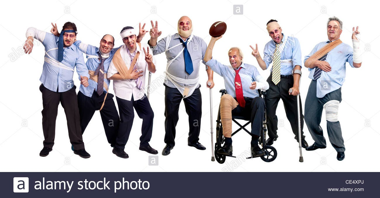 Group of injured businessmen after a rugby sevens game Stock Photo - Alamy
