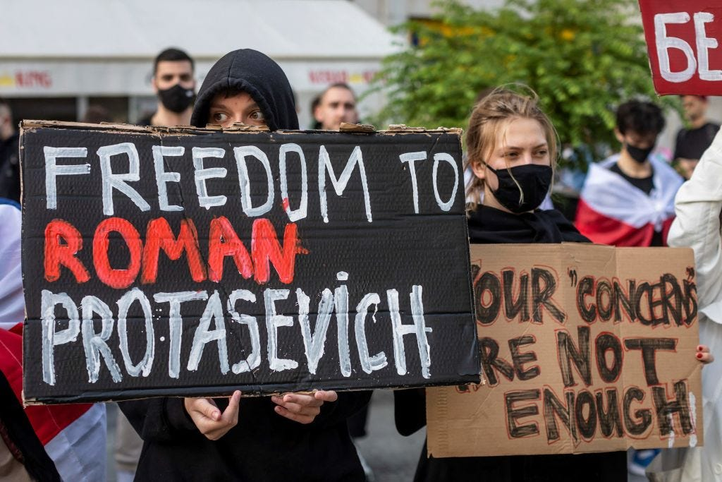 Belarusians living in Poland protest on Monday after a prominent dissident was intercepted after a military jet forced his commercial flight to land in Belarus. (Wojtek Radwanski / AFP)