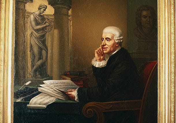 A painting of Haydn seated at a desk with sheet music