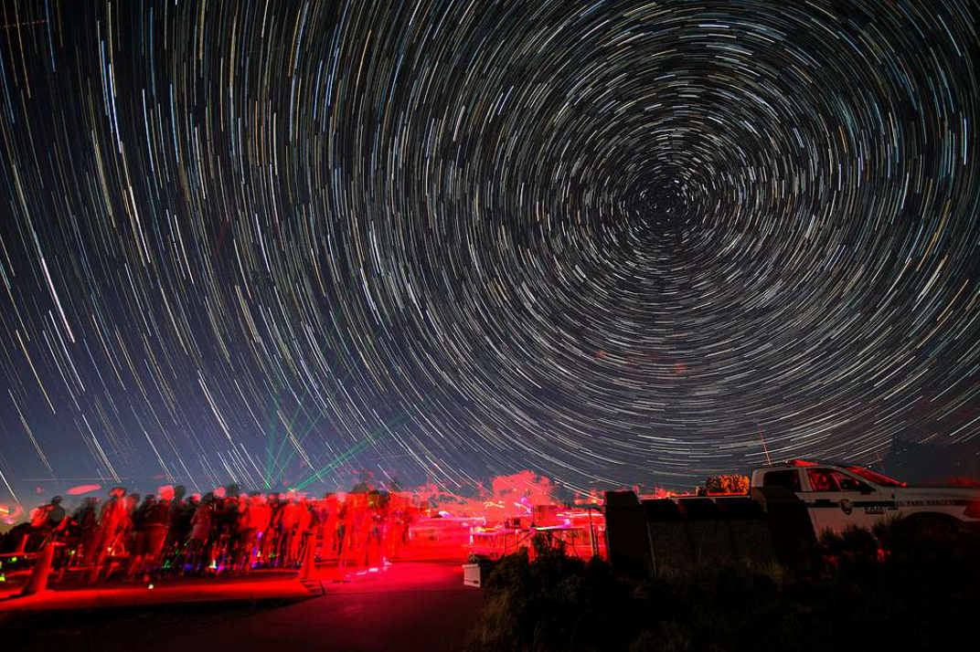 Gorgeous picture of stars on the night sky, but the stars look like lines, arranged to make a concentric set of circles