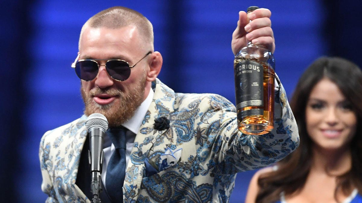 McGregor shows up to press conference with a bottle of his own 'Notorious'  whiskey - CBSSports.com
