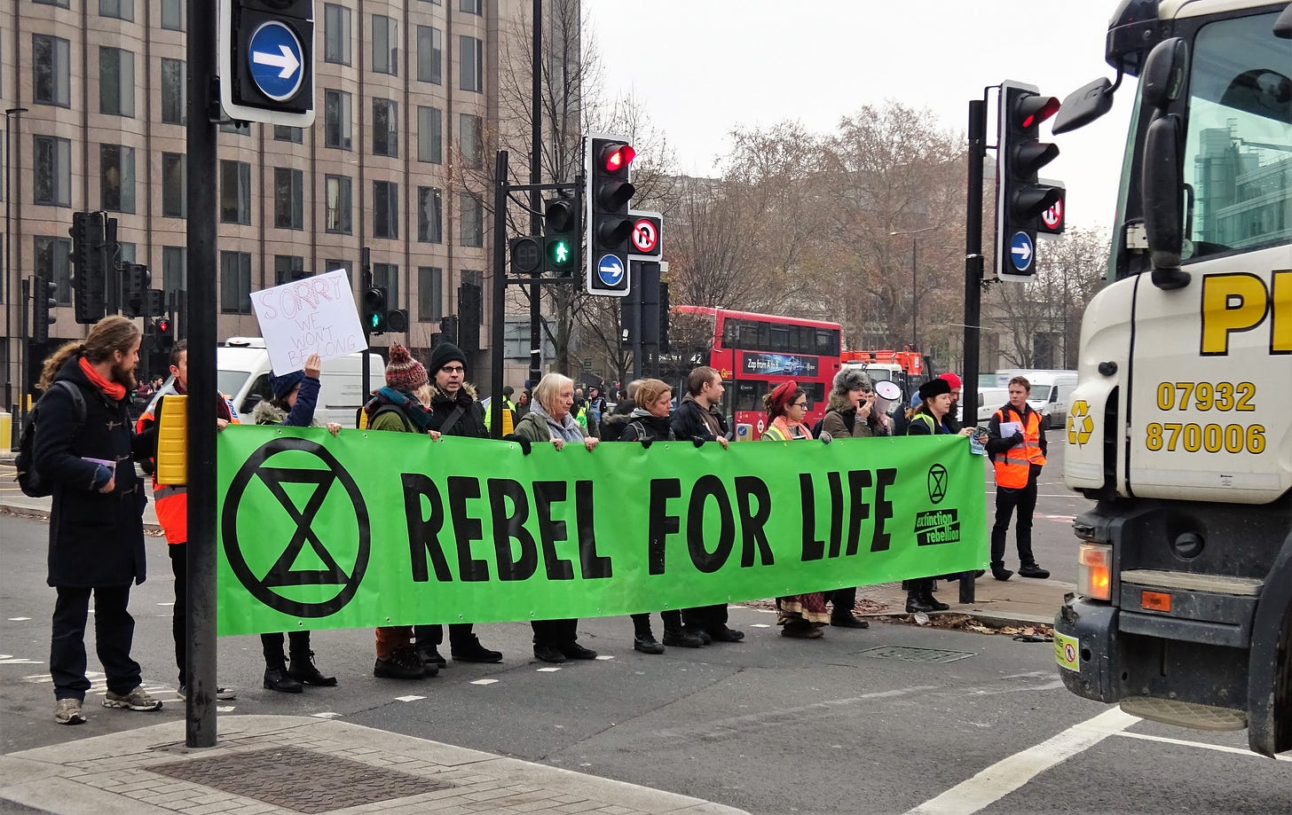"""""""File:London November 23 2018 (19) Extinction Rebellion Protest Tower Hill.jpg"""" by DAVID HOLT is licensed under CC BY 2.0"""