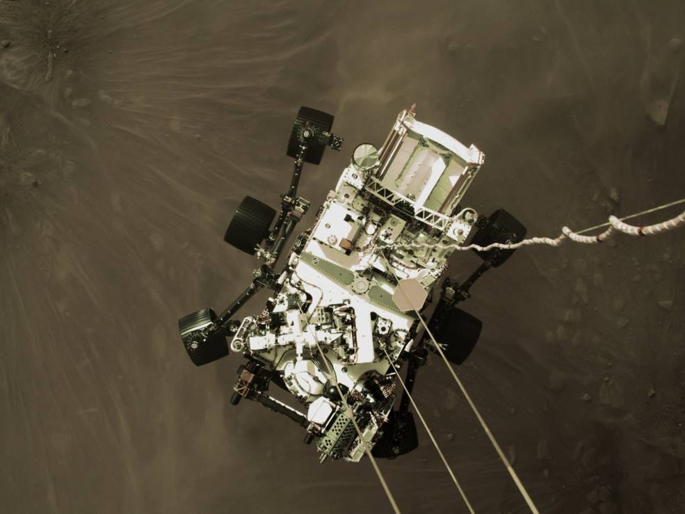 photo of the Mars Perseverance Rover descending from its skycrane