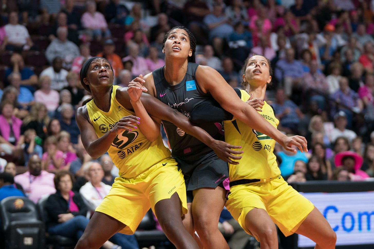 Seattle Storm forward Crystal Langhorne (1) Connecticut Sun forward Brionna Jones (42) and Seattle Storm forward Alysha Clark (32) battle for position during the WNBA game between the Seattle Storm and the Connecticut Sun at Mohegan Sun Arena, Uncasville, Connecticut, USA on August 16, 2019. Photo Credit: Chris Poss