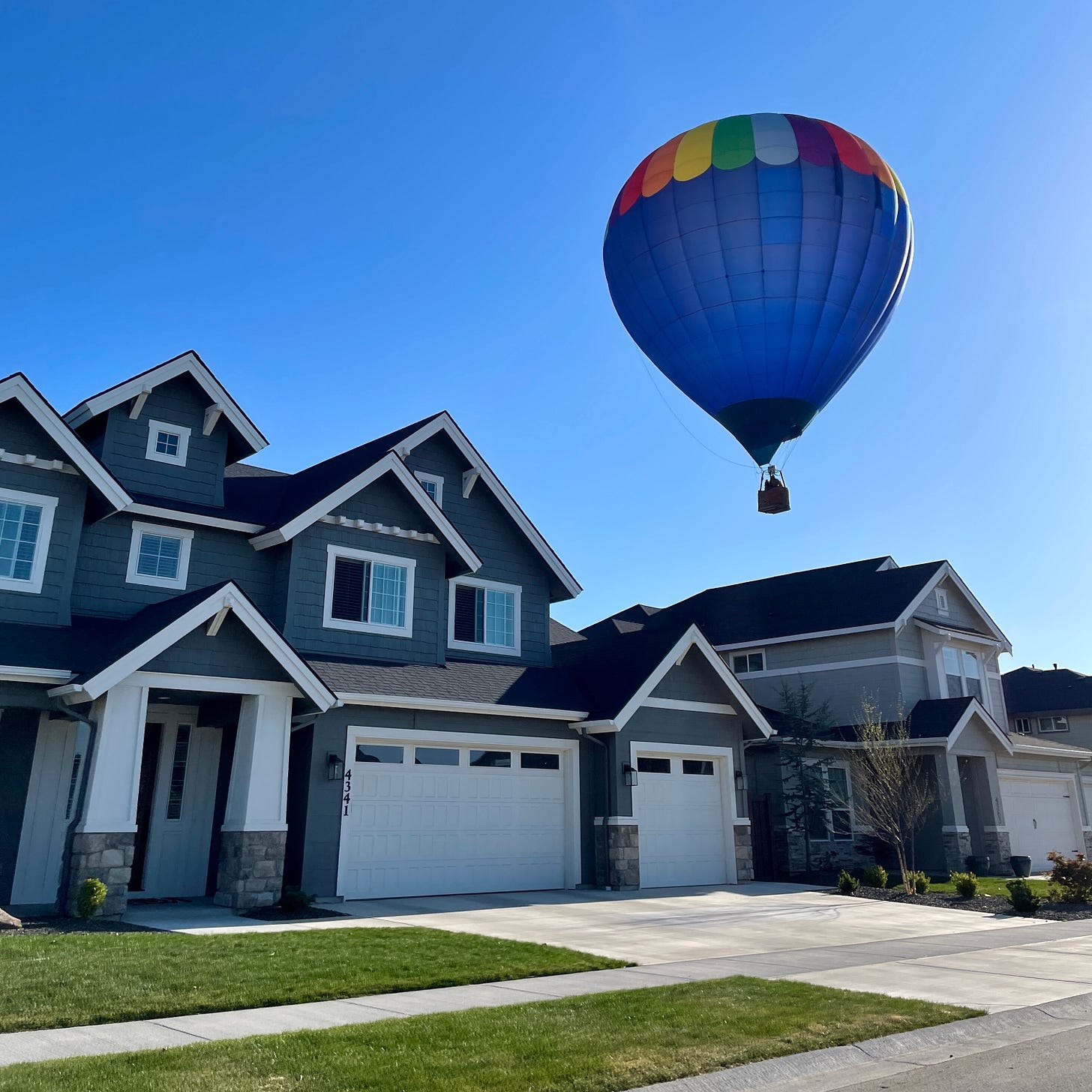 Balloon floating over home