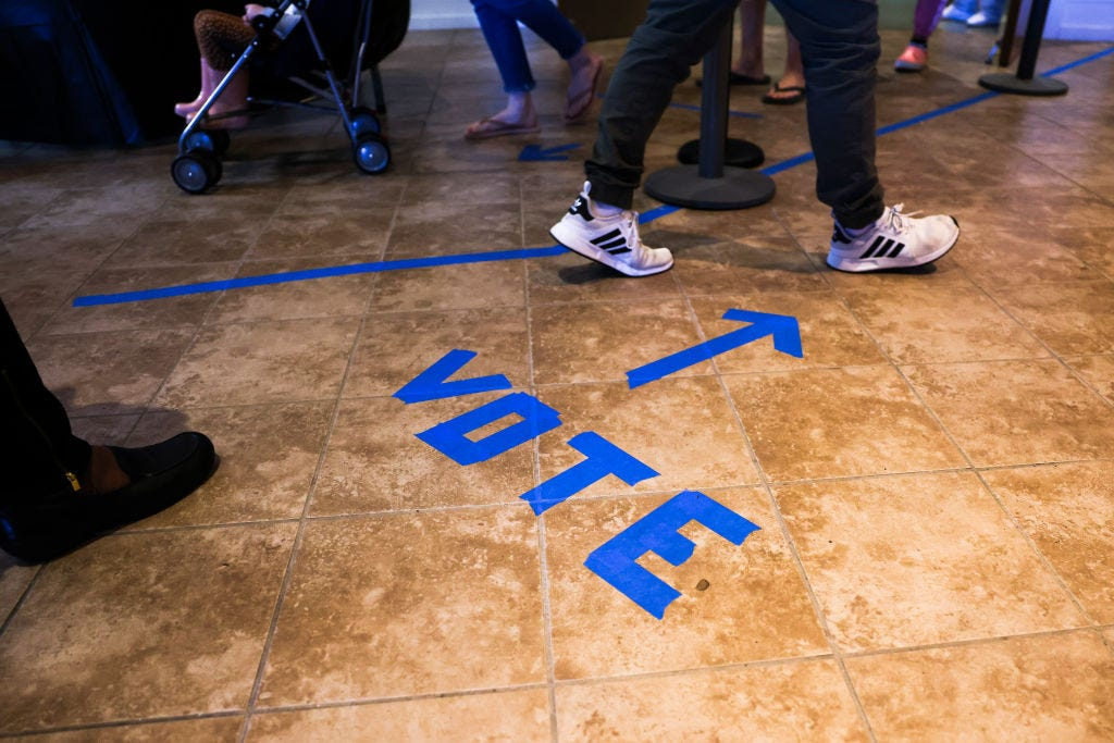 People head to the voting booths to cast their in-person absentee ballots at Seacoast Church West Ashley on October 30 in Charleston, South Carolina. (Michael Ciaglo / Getty Images)