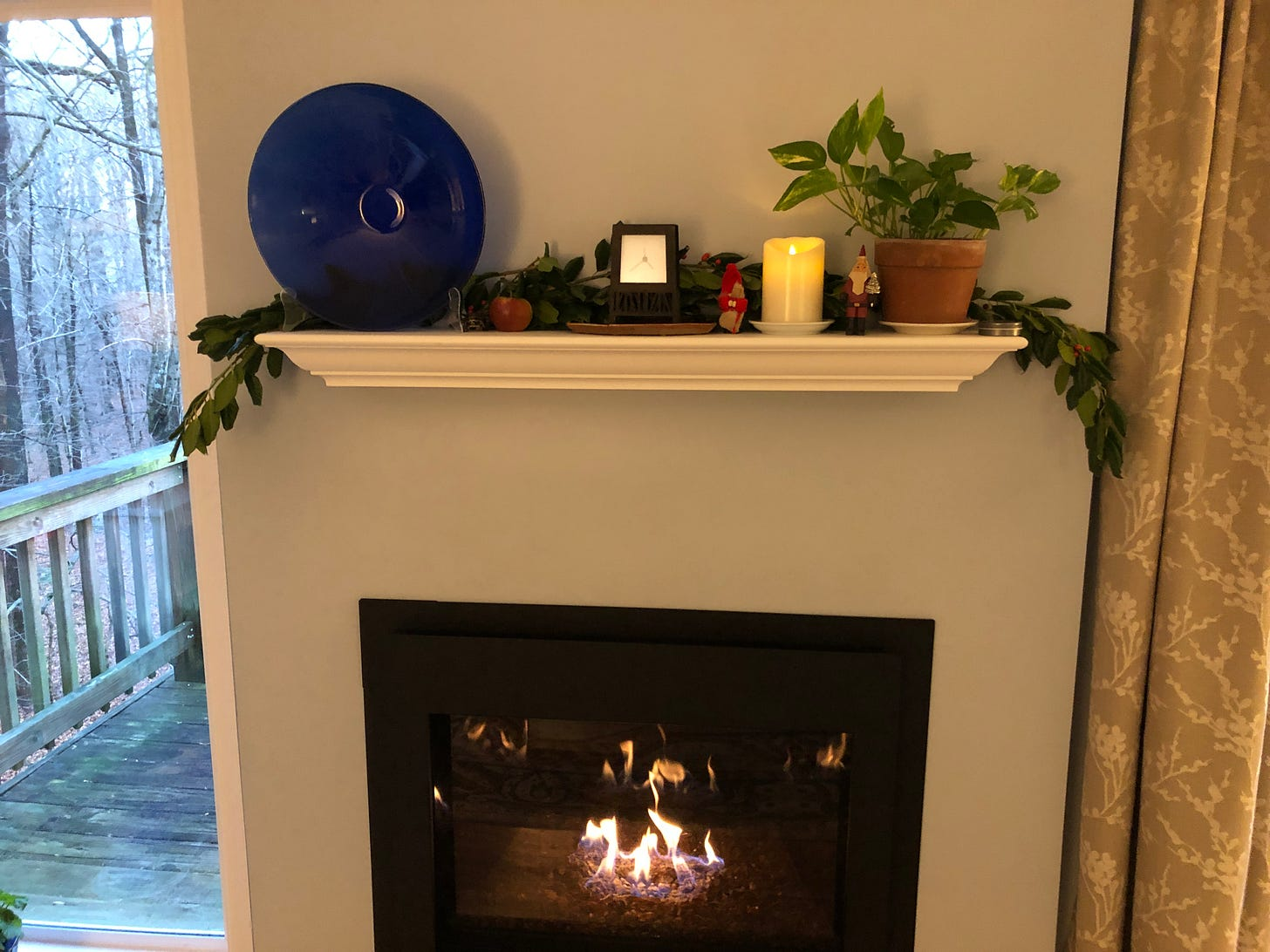 My fireplace mantel, literally decked with holly and Julenisse