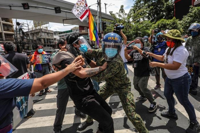Policearrest protesters during a Pride march in Manila, Philippines, June 26, 2020.