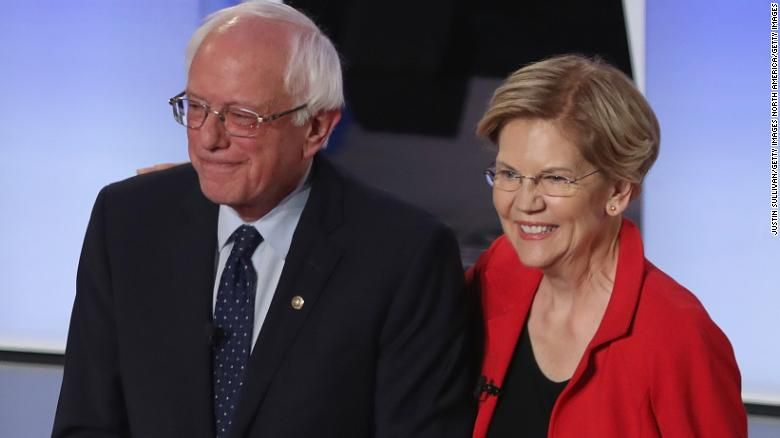 Democratic presidential candidates Sen. Bernie Sanders (I-VT) and Sen. Elizabeth Warren (D-MA) take the stage at the beginning of the Democratic Presidential Debate at the Fox Theatre July 30, 2019 in Detroit, Michigan. (Photo by Justin Sullivan/Getty Images)