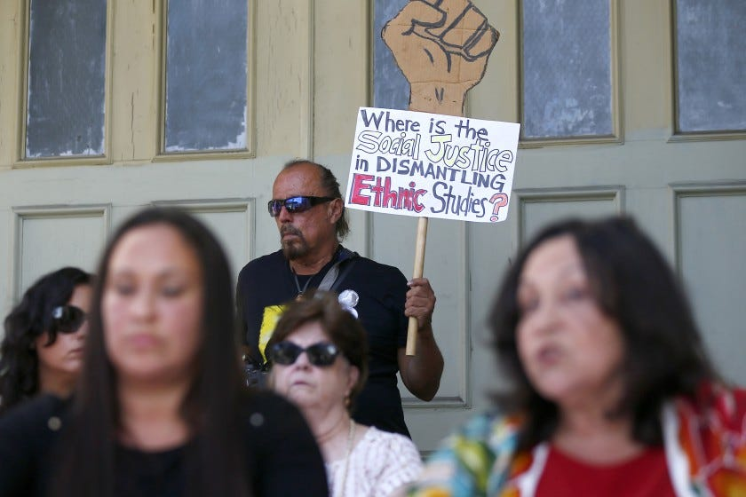 """LOS ANGELES, CALIF. - AUG. 27, 2019. John Avalos, an adjunct professor of dance at UC Riverside, joins a rally in Los Angeles on Tuesday, Aug. 27, 2019, to defend a proposed """"model"""" curriculum of ethic studies for public schools that has generated controversy. Various critics say the curriculum is not inclusive enough or that it is politically one-sided or anti-Israel or weighed down with academic jargon. Supporters defend the curriculum as is -- saying that it is a rare counter narrative to mainstream political thought. (Luis Sinco/Los Angeles Times)"""