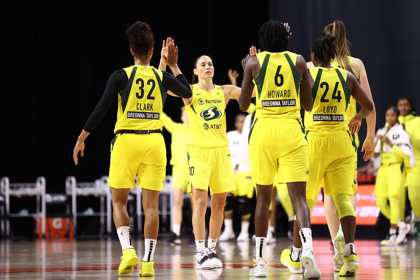PALMETTO, FL- SEPTEMBER 22: Sue Bird #10 of the Seattle Storm high fives teammates during the game against the Minnesota Lynx in Game One of the Semifinals of the 2020 WNBA Playoffs on September 22, 2020 at Feld Entertainment Center in Palmetto, Florida.
