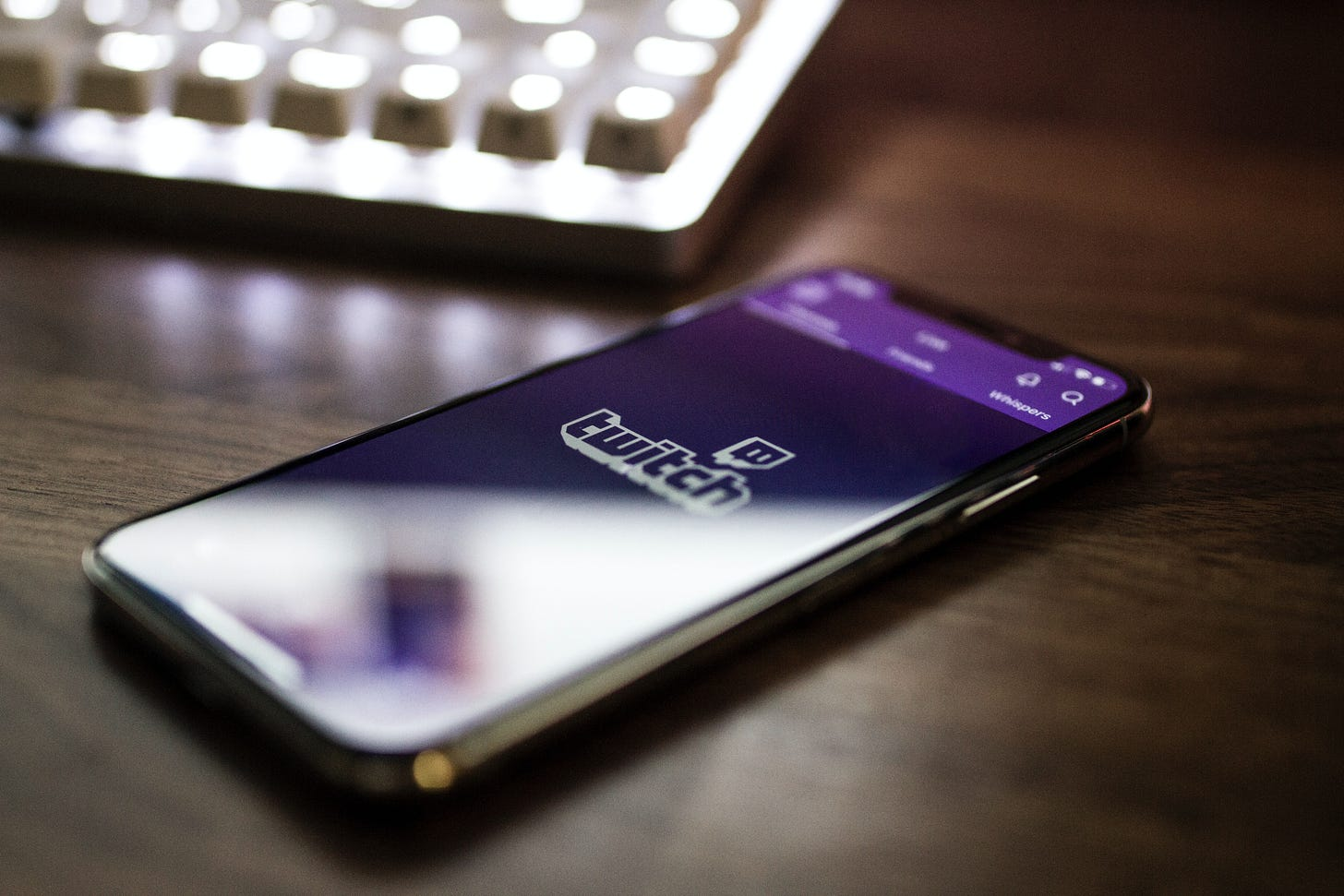 Twitch app shown on a phone laid on a desk. Caspar Camille Rubin / Unsplash