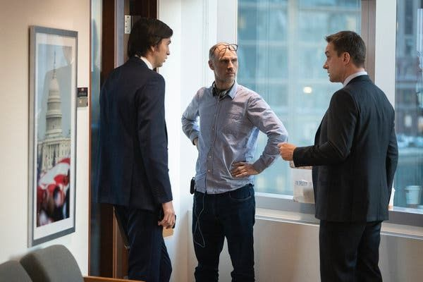 "Jesse Armstrong, center, the creator of ""Succession,"" won an Emmy last month for his writing for the series. Armstrong is pictured on set with the actors Nicholas Braun, left, and Matthew Macfadyen."