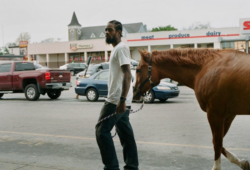 Jamil Prattis, who has maintained horses for 15 years, on Fletcher Street in 2017.