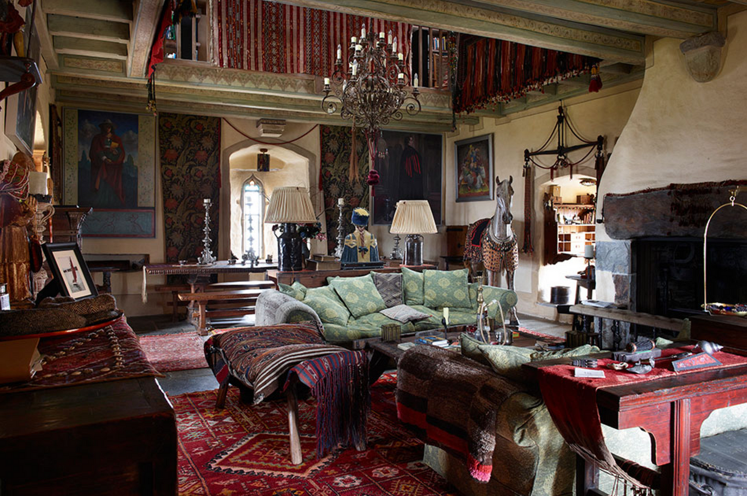The living room of Jeremy Irons castle, with life sized wooden horse.