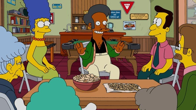 """""""The Simpsons"""" has plans for Apu, center (seen with Marge, left, and Rev. Lovejoy), according to creator Matt Groening. Hank Azaria is no longer voicing the convenience-store operator after criticism regarding a white actor voicing the Indian character."""