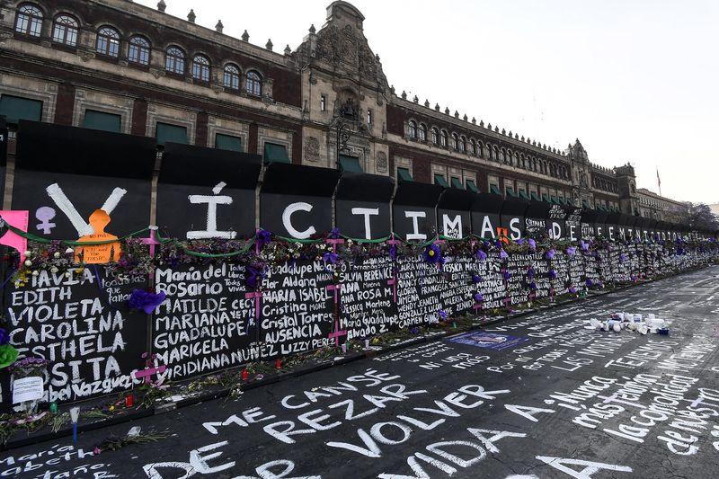 Names of femicide victims, slogans and flowers on the barricade outside Palacio Nacional ahead of International Women's Day demonstrations Photographer: Karen Melo/Getty Images