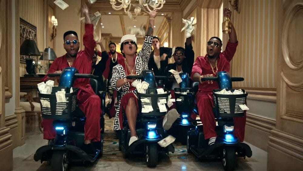 Bruno's coming for all your money and your mopeds, Macklemore.