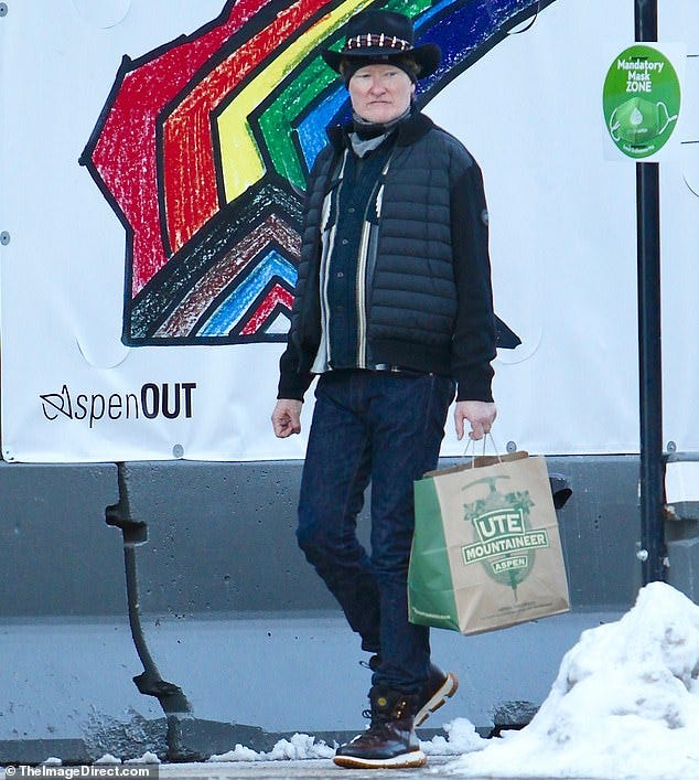 Mask off: Conan O'Brien, 57, stepped out to snag some supplies while vacationing in Aspen with his wife Liza. He was seen sans mask in a 'mandatory mask zone,' above