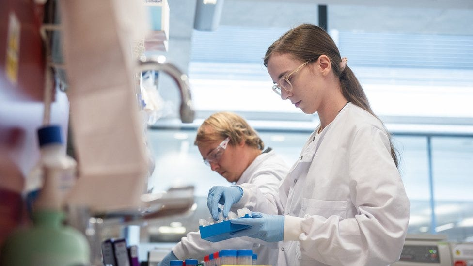 Laboratory scientist / technician handling blood samples from coronavirus vaccine trials inside Oxford University's Jenner Institute on June 25, 2020