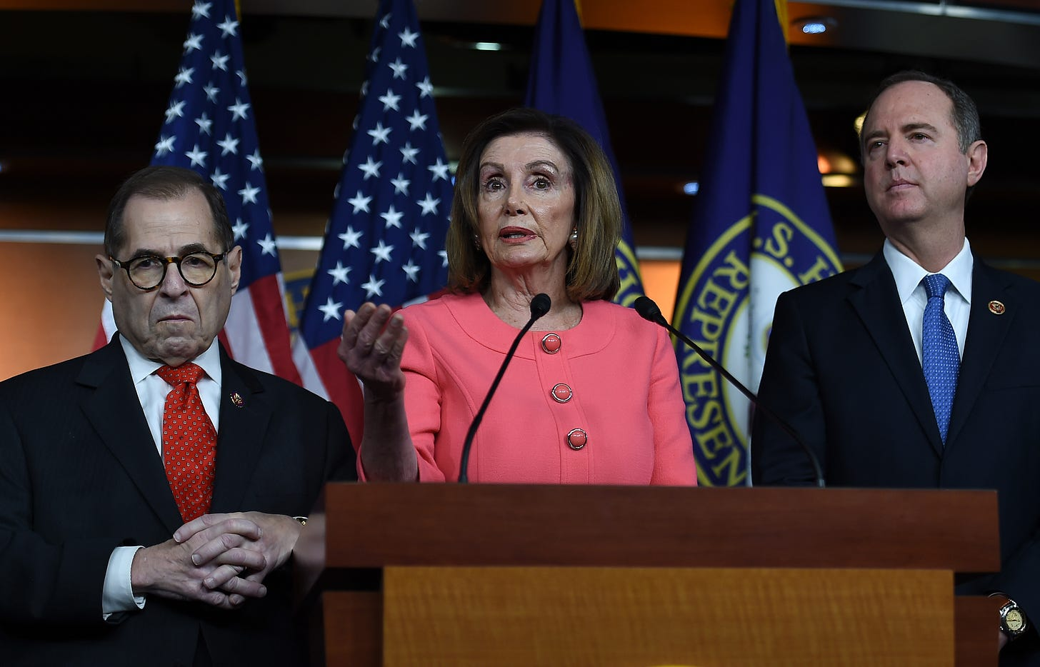US Speaker of the House Nancy Pelosi (D-CA) flanked by Rep. Adam Schiff (D-CA) (R) and Rep. Jerry Nadler (D-NY), speaks at a press conference on Capitol Hill (Photo by OLIVIER DOULIERY/AFP via Getty Images)