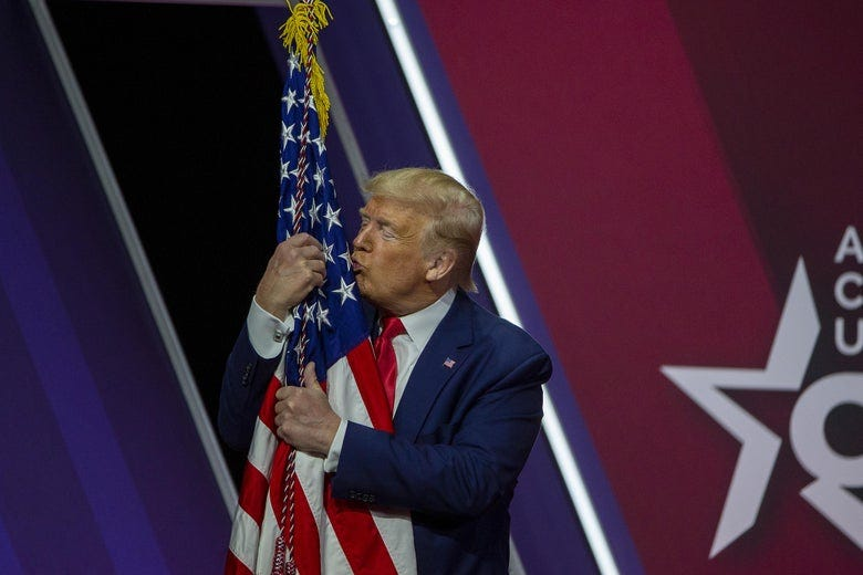 """Watch Trump kiss and caress an American flag at CPAC: """"I love you ..."""