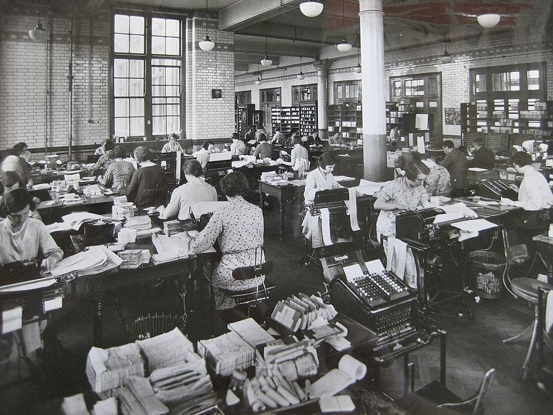 File:Blythe House preparing totals for daily balance 1930s.JPG