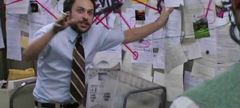 Meme of a man standing at a bulletin board covered with papers and red string connecting conspiracies