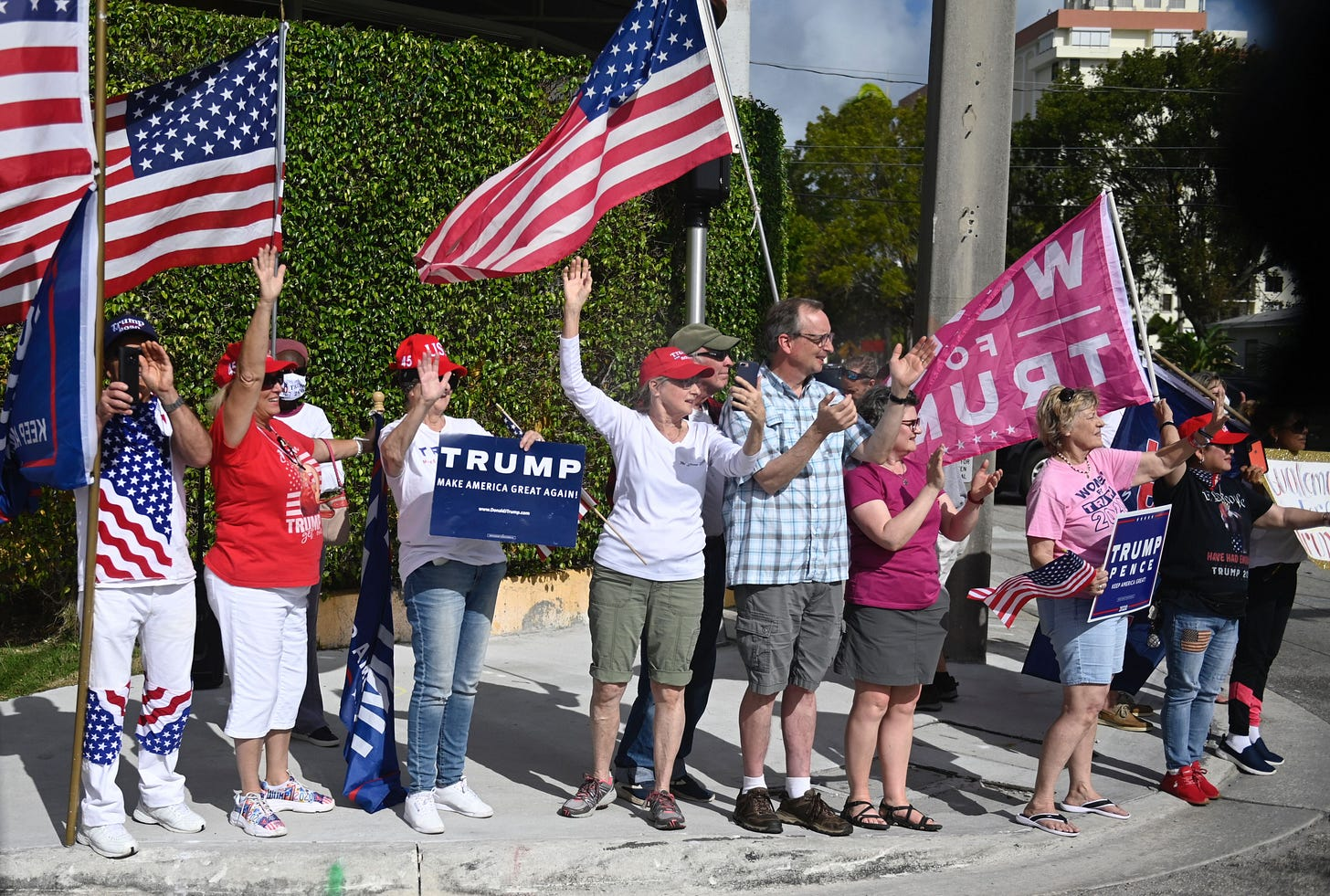 Supporters line the street as US president Donald Trump departs in West Palm Beach, Florida on December 31, 2020, as he travels back to Washington, DC after his Christmas holiday break in Mar-a-Lago. (Photo by ANDREW CABALLERO-REYNOLDS / AFP) (Photo by ANDREW CABALLERO-REYNOLDS/AFP via Getty Images)