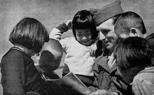 """""""AMBASSADORS OF GOODWILL: AMERICAN GI TALKING WITH CHILDREN IN JAPAN 1945"""" by roberthuffstutter is licensed under CC BY 2.0"""