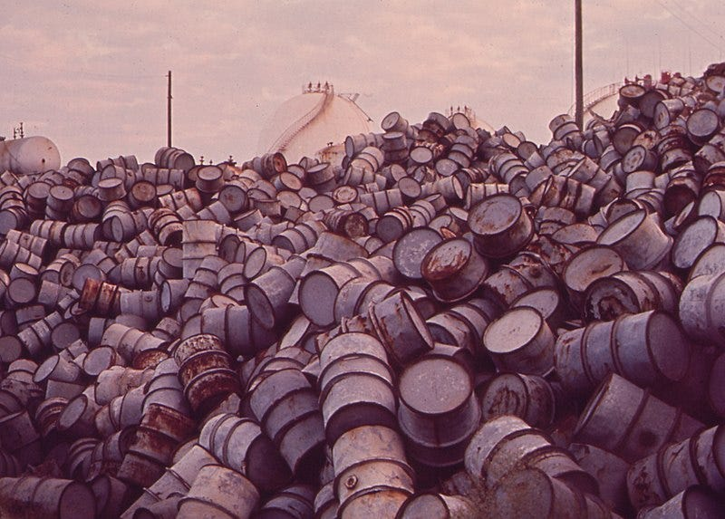File:A MOUNTAIN OF DAMAGED OIL DRUMS NEAR THE EXXON REFINERY - NARA - 546000 (cropped).jpg