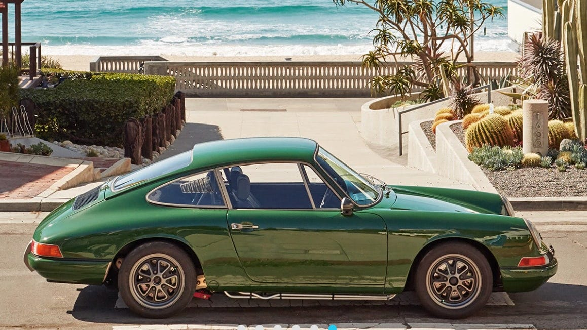 http://a 1968 porsche 911 powered by a Tesla P85 battery sits on a beautiful sunny street.