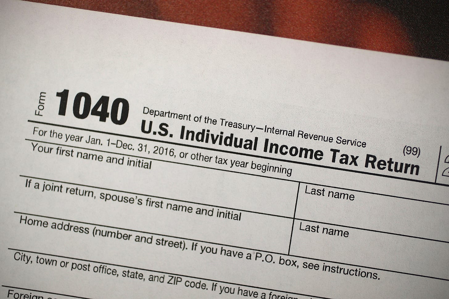 A copy of a IRS 1040 tax form is seen at an H&R Block office on the day President Donald Trump signed the Republican tax cut bill in Washington, DC on December 22, 2017 in Miami, Florida