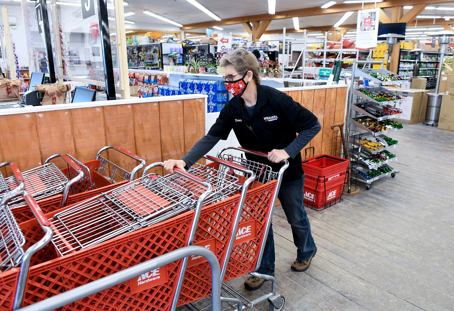 Cashier Tracy Burkert, brings shopping carts back into the store. At Weaver's Ace Hardware on Fleetwood Lyons Road in Richmond Township Monday afternoon March 1, 2021.