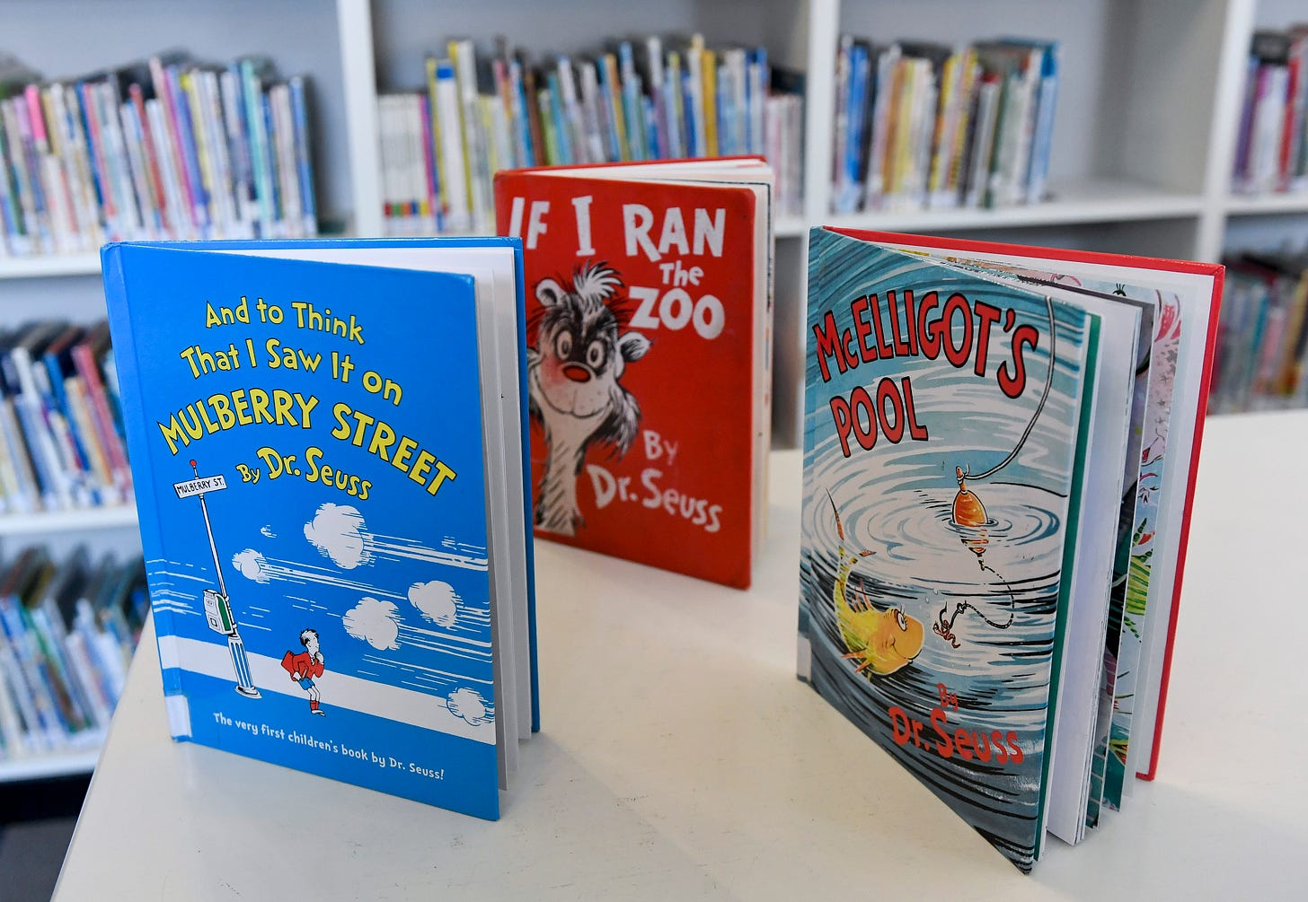 "Photo of Dr. Seuss books ""And to Think That I Saw It on Mulberry Street,"" ""If I Ran the Zoo,"" and ""McElligot's Pool"""