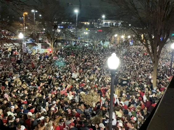 Alabama Crimson Tide fans flood the streets of Tuscaloosa after the team's college football championship win against Ohio State Monday, Jan. 11, 2021.. PHOTO BY JAMES BENEDETTO /Tuscaloosa Thread/via Reuters