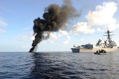 USS Haditha Watching The Suspected Pirate Skiff Burn