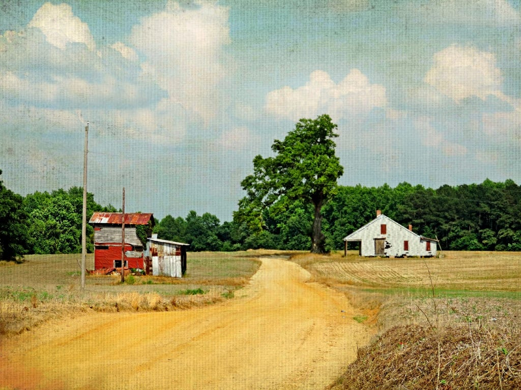 A photo of aged painting of a rural clay road in North Carolina with b red barn on the left and white shack on the right