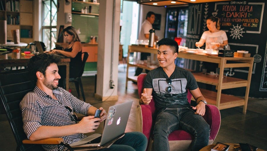 Coworking space with two men talking