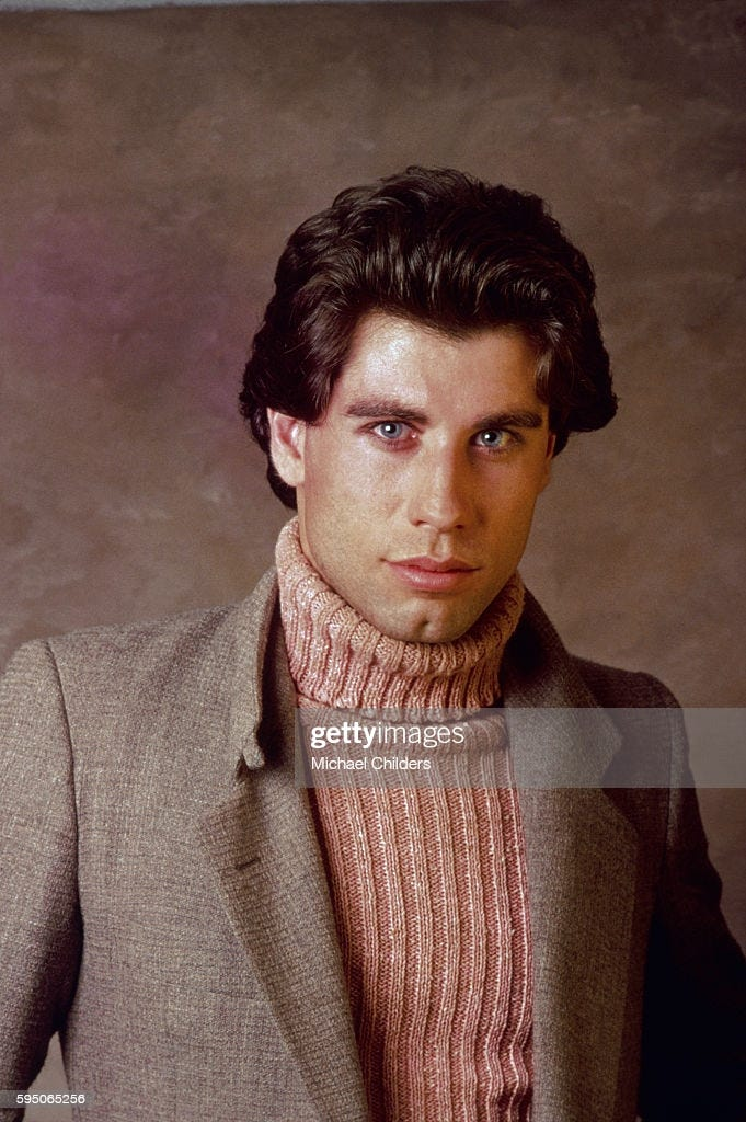 American actor John Travolta wearing brown turtleneck sweater and... News  Photo - Getty Images