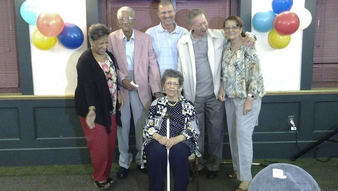Maude Guess, at center in front, is joined by her siblings from left: Barbara Williams, William Guess, Carey Guess, Emory Guess and Shirley Crowe during Maude's 90th birthday party in Boston, Ma. Maude is the oldest member of Guess clan. Sept. 15, 2014