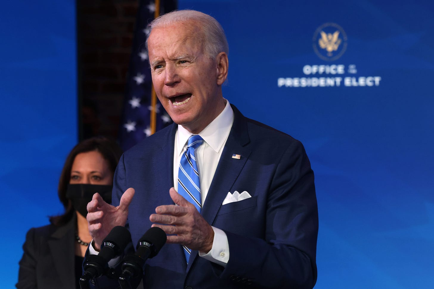 WILMINGTON, DELAWARE - JANUARY 14: U.S. President-elect Joe Biden (R) speaks as U.S. Vice President-elect Kamala Harris (L) looks on he lays out his plan for combating the coronavirus and jump-starting the nation's economy at the Queen theater January 14, 2021 in Wilmington, Delaware. President-elect Biden is expected to unveil a stimulus package with a price tag of trillions of dollars including a $1,400 direct payment to individuals who have been struggling with the economic turmoil caused by the COVID-19 pandemic. (Photo by Alex Wong/Getty Images)