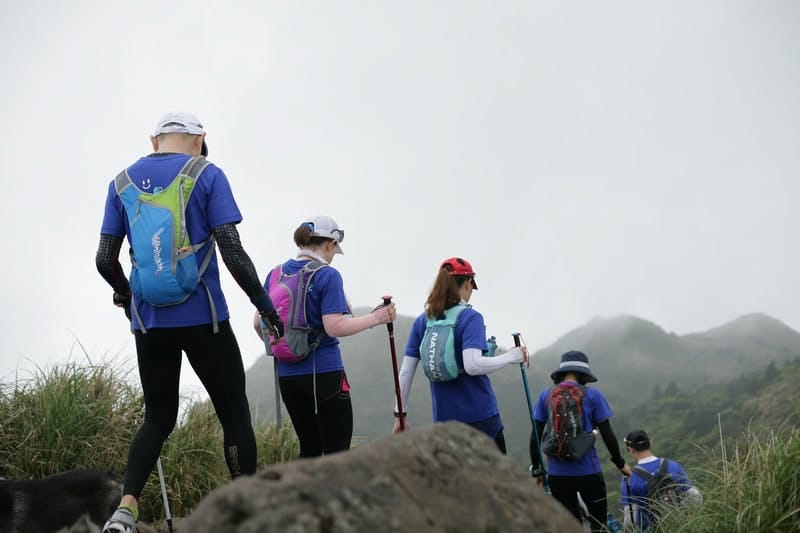 5 hikers on a trail
