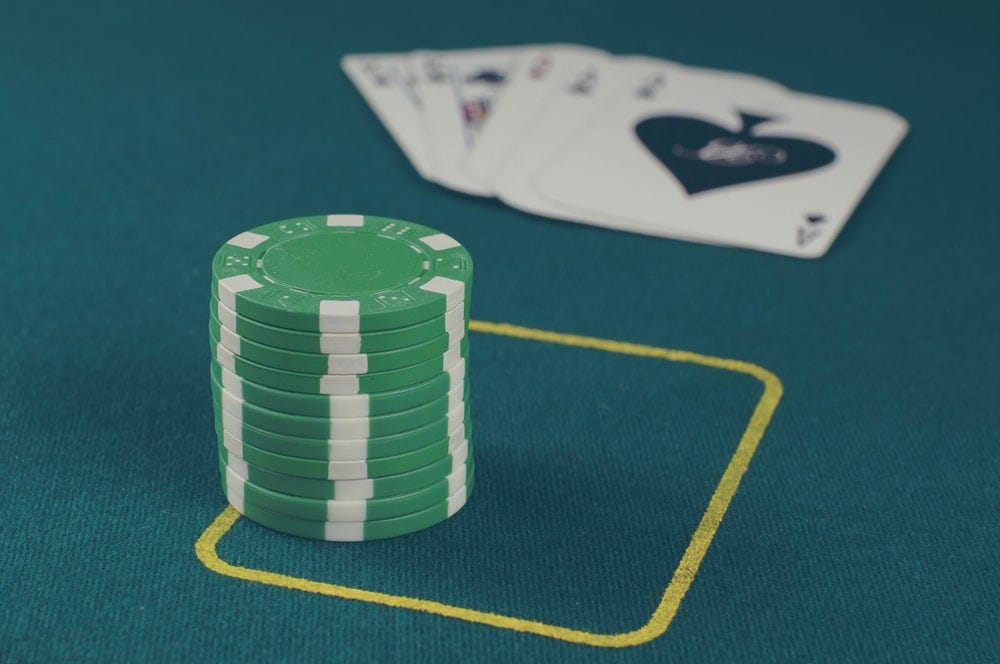 green poker chips on table