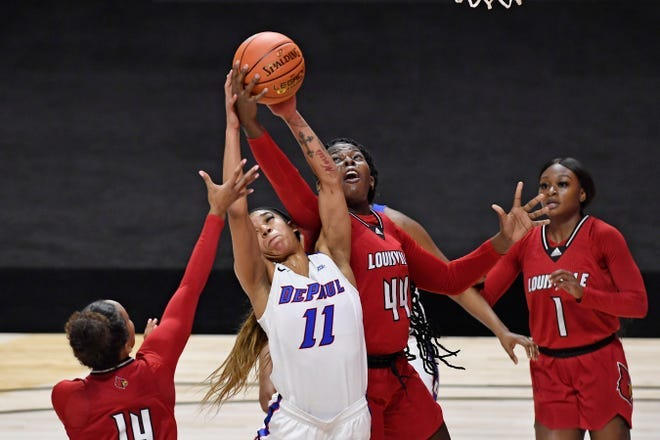 DePaul's Sonya Morris (11) and Louisville's Olivia Cochran (44) reach for a rebound Friday, Dec. 4, 2020, in Uncasville, Conn.
