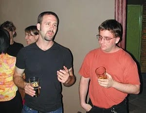 2 guys talking at a house party